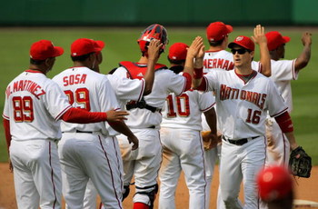 WASHINGTON - AUGUST 06:  The Washington Nationals celebrate their 12-8 victory over the Florida Marlins at Nationals Park on August 6, 2009 in Washington, DC.  (Photo by Doug Pensinger/Getty Images)