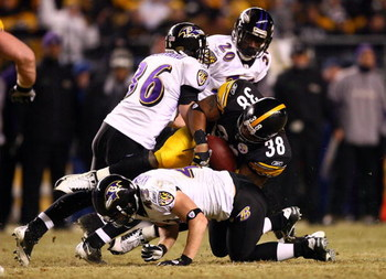 PITTSBURGH - JANUARY 18:  Carey Davis #38 of the Pittsburgh Steelers is tackled by Jim Leonhard #36, Haruki Nakamura #43 and Ed Reed #20 of the Baltimore Ravens during the AFC Championship game on January 18, 2009 at Heinz Field in Pittsburgh, Pennsylvani