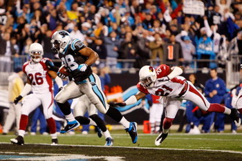 CHARLOTTE, NC - JANUARY 10:  Running back Jonathan Stewart #28 of the Carolina Panthers scores a touchdown in the first quarter against Roderick Hood #26 and Antrel Rolle #21 of the Arizona Cardinals during the NFC Divisional Playoff Game on January 10, 2