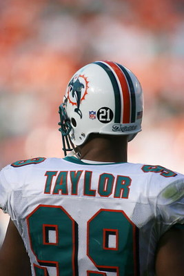 MIAMI - DECEMBER 2:  Jason Taylor #99 of the Miami Dolphins displays Sean Talyors #21 on his helmet during the NFL game against the New York Jets at the Dolphin Stadium on December 2, 2007 in Miami, Florida. (Photo by Doug Benc/Getty Images)