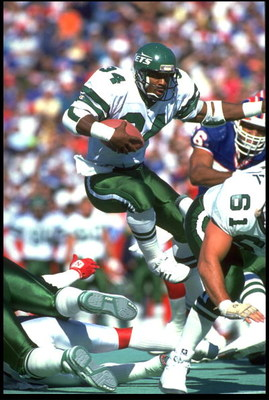 21 Oct 1991: JOHNNY HECTOR, #34, RUNNING BACK FOR THE NEW YORK JETS, LEAPS THROUGH THE LINE OF SCRIMMAGE DURING THEIR 30-27 LOSS TO THE BUFFALO BILLS AT RICH STADIUM IN ORCHARD PARK, NEW YORK.