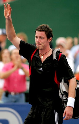 HOUSTON - NOVEMBER 20:  Marat Safin of Russia waves to the crowd after being defeated by Roger Federer of Switzerland in the semi-final match at the Tennis Masters Cup November 20, 2004 at the Westside Tennis Club in Houston, Texas. Federer won the match
