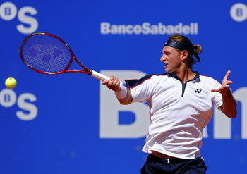 BARCELONA, SPAIN - APRIL 23:  David Nalbandian of Argentina returns a backhand to Nicolas Almagro of Spain on day four of the ATP 500 World Tour Barcelona Open Banco Sabadell 2009 tennis tournament at the Real Club de Tenis on April 23, 2009 in Barcelona,