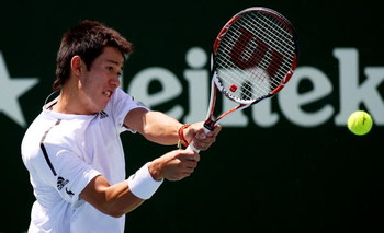 AUCKLAND, NEW ZEALAND - JANUARY 12:  Kei Nishikori of Japan plays a backhand during his first round match against Juan Carlos Ferrero of Spain during day one of the Heineken Open at ASB Tennis Centre on January 12, 2009 in Auckland, New Zealand.  (Photo b