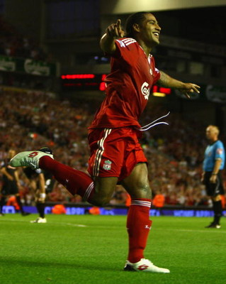 LIVERPOOL, ENGLAND - AUGUST 19:  Glen Johnson of Liverpool celebrates scoring his team's second goal during the Barclays Premier League match between Liverpool and Stoke City at Anfield on August 19, 2009 in Liverpool, England.  (Photo by Clive Brunskill/