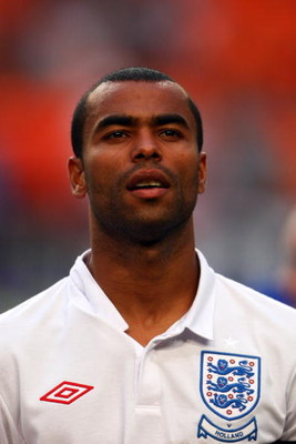 AMSTERDAM, NETHERLANDS - AUGUST 12:  Ashley Cole of England stands for the national anthem prior to the International Friendly between Netherlands and England at the Amsterdam Arena on August 12, 2009 in Amsterdam, Netherlands.  (Photo by Phil Cole/Getty