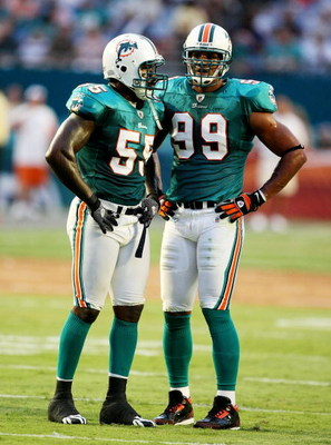 MIAMI - AUGUST 17:  Defensive end Jason Taylor #99 and linebacker Joey Porter #55 of the Miami Dolphins talk between plays against the Jacksonville Jaguars during a preseason game at Landshark Stadium on August 17, 2009 in Miami, Florida.  (Photo by Doug