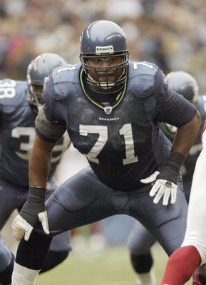 SEATTLE - SEPTEMBER 17:  Tackle Walter Jones #71 of the Seattle Seahawks gets ready for the snap against the Arizona Cardinals at Qwest Field on September 17, 2006 in Seattle, Washington. The Seahawks won 21-10. (Photo by Otto Greule Jr/Getty Images)