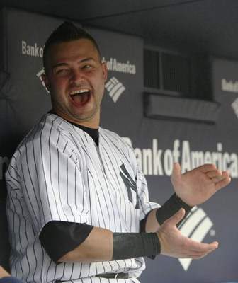 NEW YORK - JULY 2:  Nick Swisher #33 of the New York Yankees sits in the dugout before a game against the Seattle Mariners at Yankee Stadium on July 2, 2009 in the Bronx borough of New York City.  (Photo by Nick Laham/Getty Images)