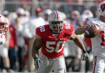 COLUMBUS, OH - NOVEMBER 03:  Vernon Gholston #50 of the Ohio State Buckeyes moves to sack Tyler Donovan #12 of the Wisconsin Badgers on November 3, 2007 at Ohio Stadium in Columbus, Ohio. Ohio State defeated Wisconsin 38-17. (Photo by Jonathan Daniel/Gett