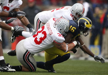 ANN ARBOR, MI - NOVEMBER 17: Adrian Arrington #16 of the Michigan Wolverines is tackled by James Laurinaitis #33 and Malcolm Jenkins #2 of the Ohio State Buckeyes on November 17, 2007 at Michigan Stadium in Ann Arbor, Michigan. Ohio State won the game 14-