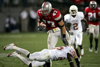 COLUMBUS, OH - SEPTEMBER 10:  Linebacker A.J. Hawk #47 of the Ohio State Buckeyes avoids the tackle of wide receiver Mark McCoy #25 of the Texas Longhorns after a fumble recovery during the second quarter at Ohio Stadium on September 10, 2005 in Columbus,