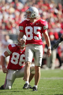 COLUMBUS, OH - OCTOBER 30:  Mike Nugent #85 and Kyle Turano #86 of the Ohio State Buckeyes watch the flight of a field goal attempt during the game against the Penn State Nittany Lions at Ohio Stadium on October 30, 2004 in Columbus, Ohio. Ohio State defe