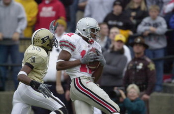 WEST LAFAYETTE, IN - NOVEMBER 9:  Split end Michael Jenkins #12 of the Ohio State Buckeyes hauls in the game-winning touchdown pass in the fourth quarter over cornerback Antwaun Rogers #12 of the Purdue Boilermakers during the Big 10 Conference football g
