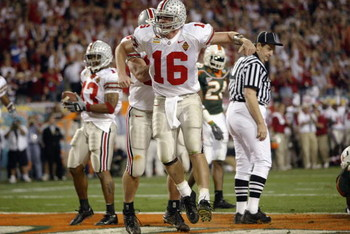 TEMPE, AZ - JANUARY 3:  Quarterback Craig Krenzel #16 of the Ohio State Buckeyes celebrates after scoring the team's first touchdown against the University of Miami Hurricanes during the Tostitos Fiesta Bowl at Sun Devil Stadium on January 3, 2003 in Temp