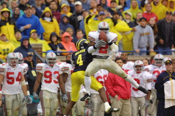 ANN ARBOR, MI - NOVEMBER 24:  Safety Michael Doss #2 of the Ohio State Buckeyes intercepts the ball over wide receiver Marquise Walker #4 of the Michigan Wolverines during the Big Ten Conference football game on November 24, 2001 at Michigan Stadium in An