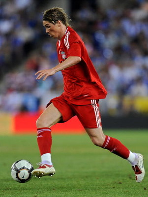 BARCELONA, SPAIN - AUGUST 02:  Fernando Torres of Liverpool runs with the ball during the pre-season friendly match between Espanyol and Liverpool at the Nuevo Estadio de Cornella-El Prat on August 2, 2009 in Barcelona, Spain. Liverpool lost the match 3-0