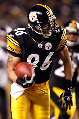 PITTSBURGH - JANUARY 18:  Hines Ward #86 of the Pittsburgh Steelers runs for yards after the catch on a 45-yard reception in the first quarter against the Baltimore Ravens during the AFC Championship game on January 18, 2009 at Heinz Field in Pittsburgh,