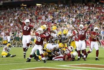 GLENDALE, AZ - AUGUST 28:  Runningback Jason Wright #31 of the Arizona Cardinals scores a 11 yard touchdown reception against the Green Bay Packers during the fourth quarter of the preseason NFL game at the Universtity of Phoenix Stadium on August 28, 200