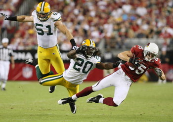 GLENDALE, AZ - AUGUST 28:  Wide receiver Jerheme Urban #85 of the Arizona Cardinals catches a pass for the first down against Atari Bigby #20 of the Green Bay Packers during the second quarter at the University of Phoenix Stadium on August 28, 2009 in Gle