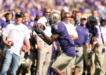 SEATTLE - SEPTEMBER 6:  D'Andre Goodwin #11 of the Washington Huskies holds on to the ball during their game against the BYU Cougars on September 6, 2008 at Husky Stadium in Seattle, Washington. The Cougars defeated the Huskies 28-27. (Photo by Otto Greul