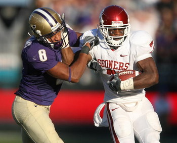 SEATTLE - SEPTEMBER 13:  Running back DeMarco Murray #7 of the Oklahoma Sooners rushes against Nate Williams #8 of the Washington Huskies on September 13, 2008 at Husky Stadium in Seattle Washington. (Photo by Otto Greule Jr/Getty Images)