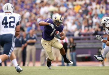 SEATTLE - SEPTEMBER 6:  Chris Polk #1 of the Washington Huskies runs with the ball against the BYU Cougars during the game on September 6, 2008 at Husky Stadium in Seattle, Washington. The Cougars defeated the Huskies 28-27. (Photo by Otto Greule Jr/Getty