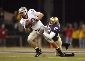 SEATTLE - NOVEMBER 24: Devin Frischknecht #80 of the Washington State Cougars carries the ball against E.J. Savannah #22 of the Washington Huskies during the 100th Apple Cup Game at Husky Stadium on November 24, 2007 in Seattle, Washington. (Photo by Otto