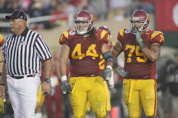 PASADENA, CA - JANUARY 1:  Christian Tupou #44 of the USC Trojans and Fili Moala #75 look on against the Penn State Nittany Lions on January 1, 2009 at the Rose Bowl in Pasadena, California.  USC won 38-24.  (Photo by Jeff Golden/Getty Images)