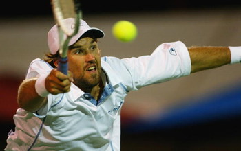 ADELAIDE, AUSTRALIA - JANUARY 8:  Patrick Rafter of Australia in action in his  doubles match with Joshua Eagles against Mark Merklein of the Bahamas and Vincent Spadea of the USA in the AAPT Championships at Memorial Drive January 8, 2004 in Adelaide, Au