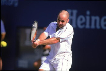 31 Aug 2000: Andre Agassi of the US swings at the ball in a match against Arnaud Clement of France during the US Open at the USTA National Tennis Center in Flushing Meadows, New York.  Arnaud Clement defeated Andre Agassi (1)6-3, 6-2, 6-4..Mandatory Credi