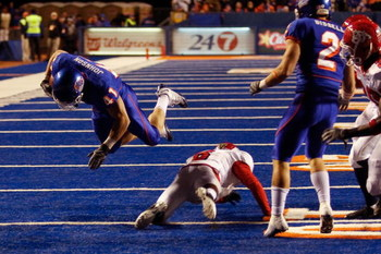 BOISE, ID - NOVEMBER 28:  Ian Johnson #41 of the Boise State Broncos dives over a Fresno State Bulldog during their game on November 28, 2008 at Bronco Stadium in Boise, Idaho.  (Photo by Otto Kitsinger III/Getty Images)