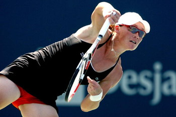 TORONTO, ON - AUGUST 21:  Samantha Stosur of Australia serves to Elena Dementieva of Russia during the Rogers Cup at the Rexall Center on August 21, 2009 in Toronto, Ontario, Canada.  (Photo by Matthew Stockman/Getty Images)