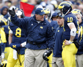 ANN ARBOR, MI - OCTOBER 25: Head coach Rich Rodriguez of the Michigan Wolverines talks with Steven Threet #10 while playing the Michigan State Spartans on October 25, 2008 at Michigan Stadium in Ann Arbor, Michigan.  (Photo by Gregory Shamus/Getty Images)