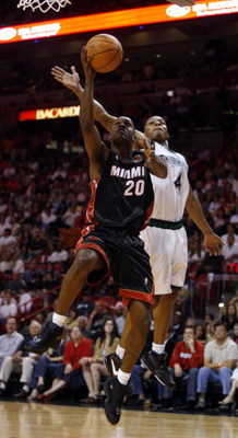 MIAMI - MARCH 9:  Guard Gary Payton #20 of the Miami Heat shoots over Guard Randy Foye #4 of the Minnesota Timberwolves at the American Airlines Arena March 9, 2007 in Miami, Florida. NOTE TO USER: User expressly acknowledges and agrees that, by downloadi