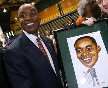 MIAMI - APRIL 15:  Isiah Thomas is presented with artwork by Fernando Ottati after he was introduced as the new head coach for Florida International Univeristy men's basketball team at U.S.Century Bank Arena on April 15, 2009 in Miami, Florida.  (Photo by