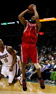 MILWAUKEE - FEBRUARY 09: Tracy McGrady #1 of the Houston Rockets puts up a shot over Keith Bogans #10 of the Milwaukee Bucks on February 9, 2009 at the Bradley Center in Milwaukee, Wisconsin. The Bucks defeated the Rockets 124-112. NOTE TO USER: User expr
