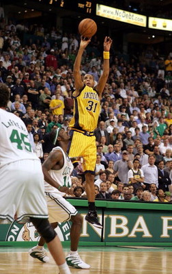 BOSTON - MAY 3:  Reggie Miller #31 of the Indiana Pacers scores a three point goal late in the game over Ricky Davis #12 of the Boston Celtics, Game five of the Eastern Conference Quarterfinals during the 2005 NBA Playoffs at Fleet Center on May 3, 2005 i