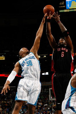 NEW ORLEANS - FEBRUARY 06:  Jermaine O'Neal #6 of the Toronto Raptors makes a shot over David West #30 of the New Orleans Hornets on February 6, 2009 in New Orleans, Louisiana. The Hornets defeated the Raptors 101-92.   NOTE TO USER: User expressly acknow