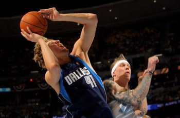 DENVER - MAY 13:  Dirk Nowitzki #41 of the Dallas Mavericks is fouled by Chris Andersen #11 of the Denver Nuggets as he sinks a shot and enroute to a three-point play in Game Five of the Western Conference Semifinals during the 2009 NBA Playoffs at Pepsi 