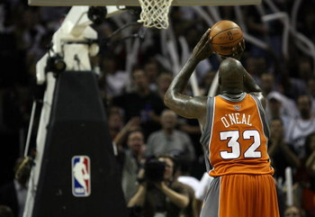 SAN ANTONIO - APRIL 22: Center Shaquille O'Neal #32 of the Phoenix Suns takes a freethrow against the San Antonio Spurs in Game Two of the Western Conference Quarterfinals during the 2008 NBA Playoffs at the AT&amp;T Center on April 22, 2008 in San Antonio, T