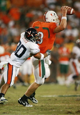 CORAL GABLES, FL - NOVEMBER 10:  Safety Nate Lyles #30 of the Virginia Cavaliers sacks quarterback Kyle Wright #3 of the Miami Hurricanes at the Orange Bowl November 10, 2007 in Coral Gables, Florida.  (Photo by Doug Benc/Getty Images)