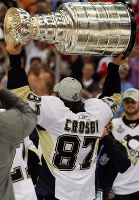 DETROIT - JUNE 12:  Sidney Crosby #87 of the Pittsburgh Penguins celebrates with the Stanley Cup after defeating the Detroit Red Wings by a score of 2-1 to win Game Seven and the 2009 NHL Stanley Cup Finals at Joe Louis Arena on June 12, 2009 in Detroit,