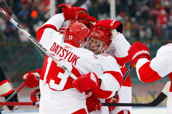 CHICAGO - JANUARY 01:  (L-R) Pavel Datsyuk #13 and Brian Rafalski #28 of the Detroit Red Wings celebrate after Datsyuk scored a goal in the second period against the Chicago Blackhawks during the NHL Winter Classic at Wrigley Field on January 1, 2009 in C