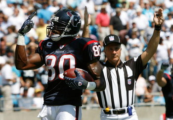 CHARLOTTE, NC - SEPTEMBER 16:  Receiver Andre Johnson #80 of the Houston Texans signals to the crowd that he has two touchdowns in the first half of their 34-21 win over the Carolina Panthers at Bank of America Stadium on September 16, 2007 in Charlotte,