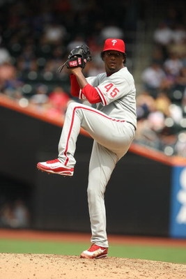 NEW YORK - AUGUST 23:  Pedro Martinez #45 of the Philadelphia Phillies pitches against The New York Mets during their game on August 23, 2009 at Citi Field in the Flushing neighborhood of the Queens borough of New York City.  (Photo by Al Bello/Getty Imag