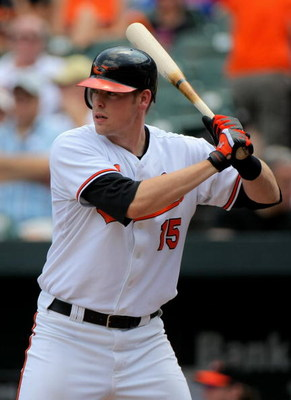 BALTIMORE - JULY 30:  Matt Wieters #15 of the Baltimore Orioles takes an at bat against the Kansas City Royals during MLB action at Oriole Park at Camden Yards on July 30, 2009 in Baltimore, Maryland. The Orioles defeated the Royals 7-3.  (Photo by Doug P