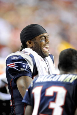 LANDOVER, MD - AUGUST 28:  Randy Moss #81 of the New England Patriots laughs with teammates while on the sideline during a preseason game against the Washington Redskins at FedExField on August 28, 2009 in Landover, Maryland.  (Photo by Greg Fiume/Getty I