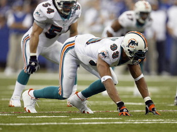 INDIANAPOLIS - DECEMBER 31: Jason Taylor #99 of the Miami Dolphins gets ready to move at the snap during the game against the Indianapolis Colts at the RCA Dome on December 31, 2006 in Indianapolis, Indiana. Indianapolis won the game 27-22. (Photo by Greg