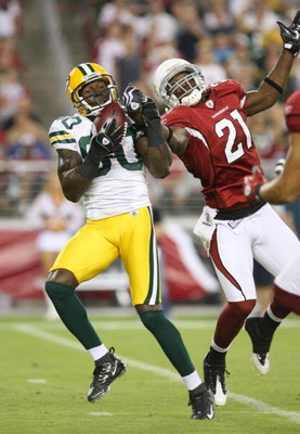 GLENDALE, AZ - AUGUST 28:  Wide receiver Donald Driver #80 of the Green Bay Packers catches a 55 yard pass against Antrel Rolle #21 of the Arizona Cardinals during the second quarter at the University of Phoenix Stadium on August 28, 2009 in Glendale, Ari